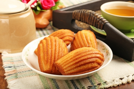 madeleine: Madeleine cookie and cup of tea