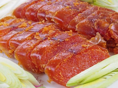 Slices of mullet roe on the white plate Foto de archivo