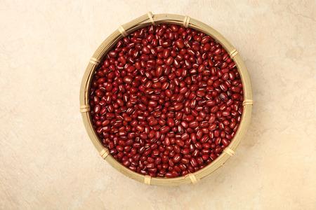 adzuki: Red adzuki beans  in a basket Stock Photo