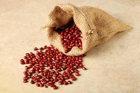 adzuki:  Red adzuki beans and bag      Stock Photo
