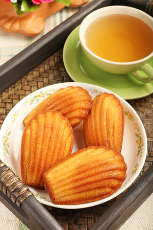 madeleine: Madeleine cookie and cup of tea