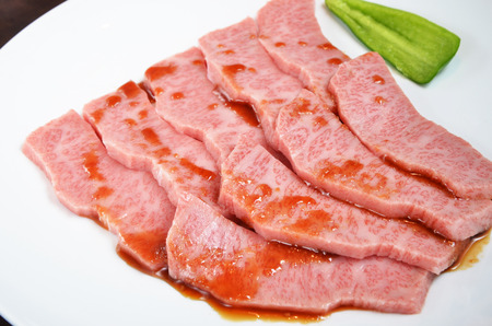 thinly: Thinly sliced beef on white plate