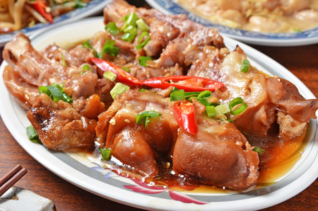fat pigs: Delicious  braised pig knuckles on the table