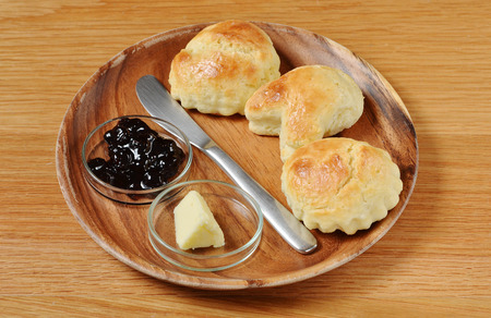 scone: Scone with jam on wooden plate