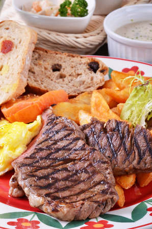 beefsteak: Closeup of beefsteak  with french fries and vegetables Stock Photo