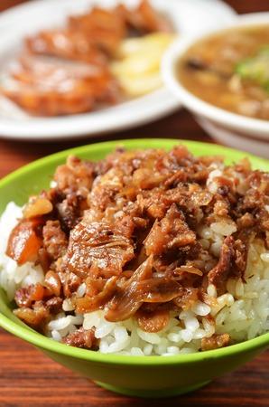 Braised pork rice on wood table