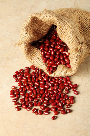 adzuki bean: Red adzuki beans and bag Stock Photo
