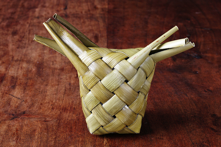 meat diet: Taiwans aboriginal (amis nation) traditional food made with sticky rice & pork wrapped in leaves Stock Photo