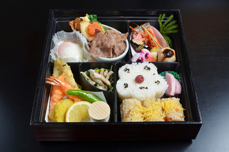 bento: Japanese lunch box on black background Stock Photo
