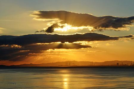 cloudy sky: Beautiful sunrise over the quiet calm sea.