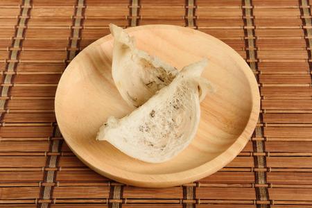 edible: Edible birds nest on wooden plate Stock Photo