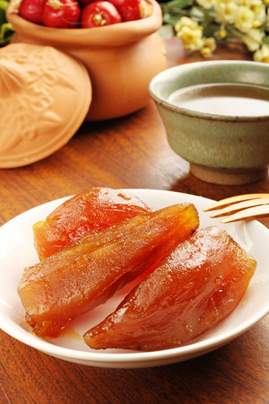 asian flavors: Caramelized sweet potato on the white plate