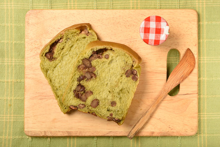 beans on toast: Green tea toast with red beans on wooden cutting board Stock Photo