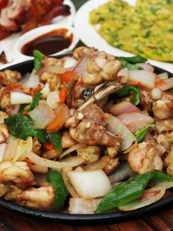 bullfrog: Sizzling bullfrog with vegetables served on iron plate