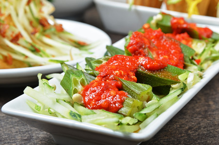 cuisine: Malaysian cuisine - Okra with spicy sauce on white plate