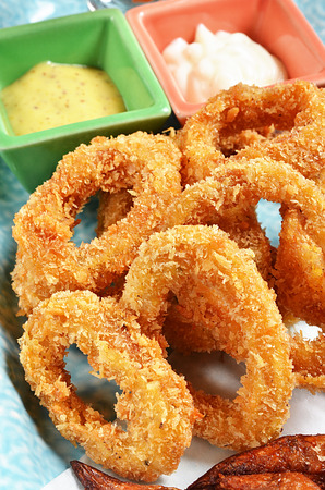 sauce bowl: Deep fried squid rings with sauce bowl. Stock Photo