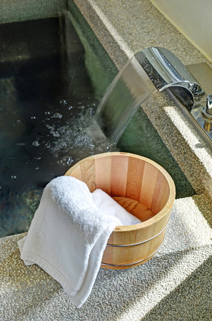 hot spring: Bath bucket with a towel at a hot spring bath at Japanese onsen