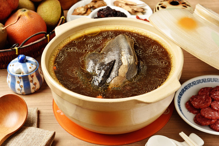 Chinese black chicken soup with herbs