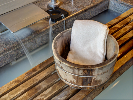lave: Bath bucket with a towel at a hot spring bath at Japanese onsen