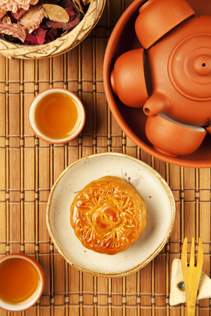 Moon cake and tea, Chinese mid autumn festival food.