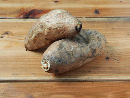 diet dinner: Roasted sweet potatoes on wooden table Stock Photo