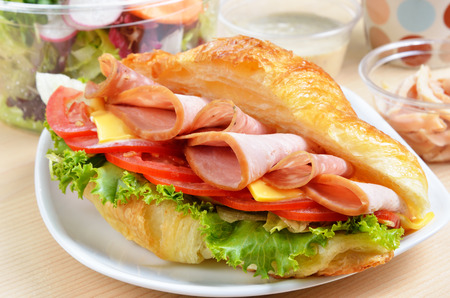 Fresh croissant with ham and cheese