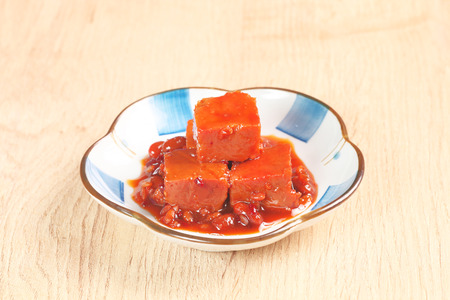 bean curd: A plate of fermented bean curd on the dinner table