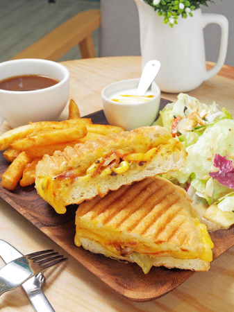 Grilled cuban sandwich with ham, cheese, pickle, and mustard. Stock Photo - 84185665
