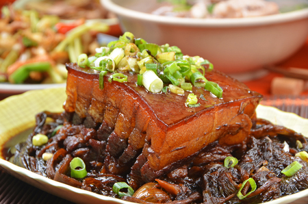 Taiwans hakka traditional cuisine - Stewed pork belly with pickled vegetables Фото со стока