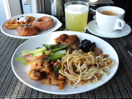 Asian style breakfast buffet on the table at hotel Stock Photo