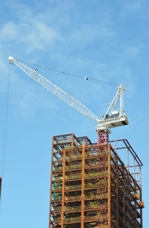 A tower crane over unfinished building