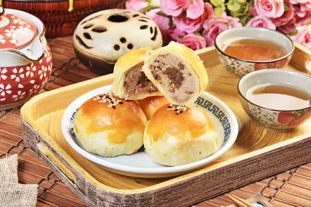 Purple taro paste with minced pork sauce moon cake, Chinese mid autumn festival food.