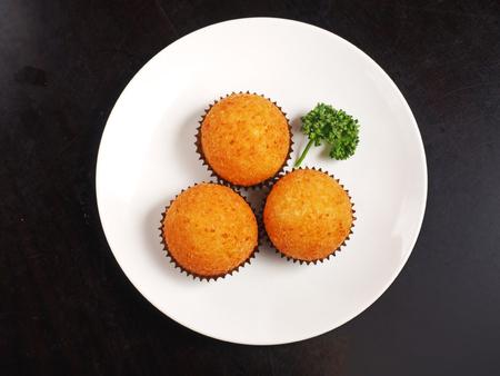 Golden custard balls stuff with custard lava on the plate
