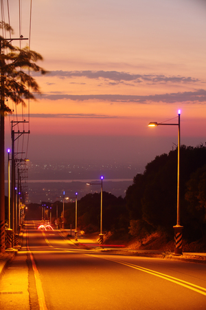 Sunset over an empty road in Taichung ,Taiwan Stok Fotoğraf