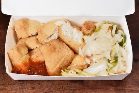 Stinky tofu in takeout food box
