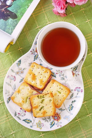 Scallion cookie nougats with tea on the plate