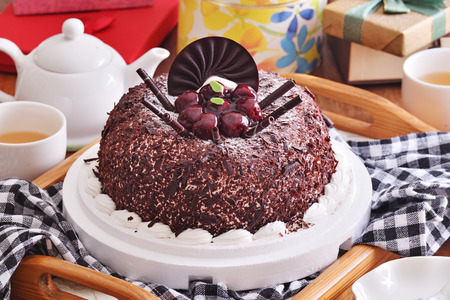 Chocolate cake with blueberry on the birthday party 写真素材