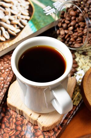 Cup of Ethiopian coffee with coffee beans on a wooden table Reklamní fotografie