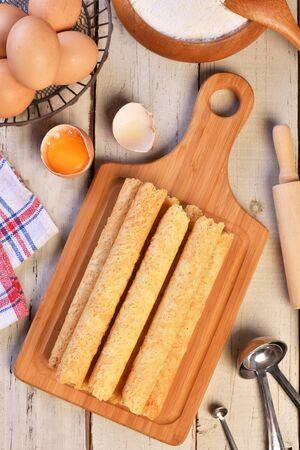Handmade egg rolls on the wooden board