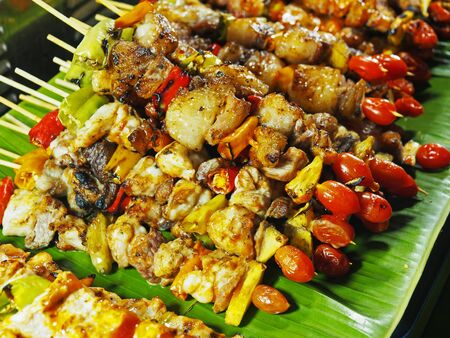 Skewers of grilled vegetables and meat in night market, thailand