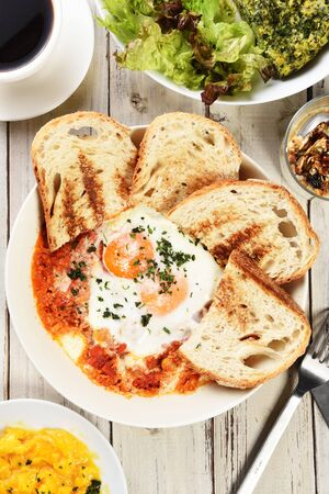 Sunny side up eggs with crsipy toast on the plate Reklamní fotografie