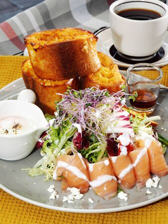 Breakfast of french toast with smoked salmon and salad