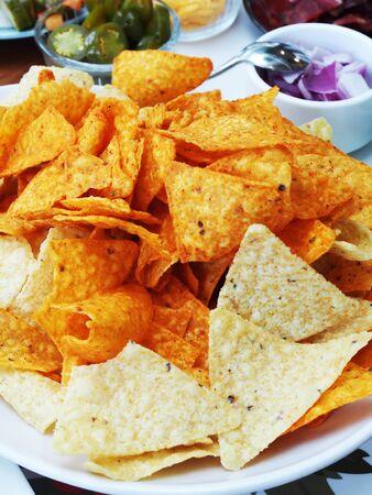 Close up of corn chips on white plate Reklamní fotografie