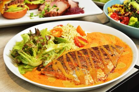 Fried sea bass with vegetables and sauce