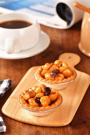 Macadamia nuts tart on wooden table