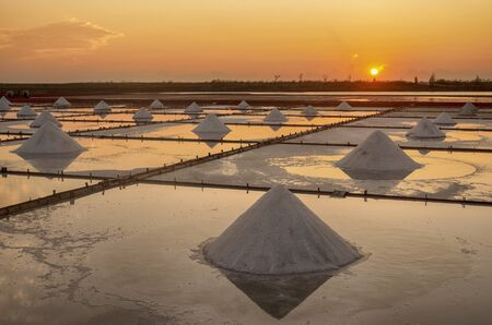 Sea salt evaporation pond with golden sunset sky background in Tainan, Taiwan