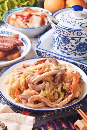 Stir-fried Chinese sauerkraut with pork stomach on the white plate
