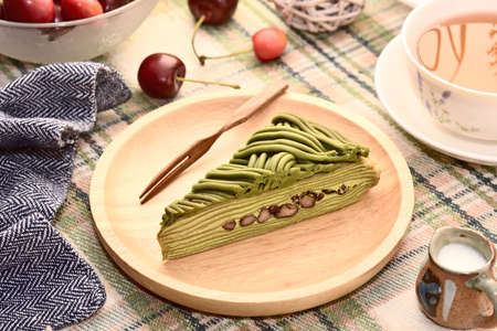 Matcha mille crepes cake on wooden plate