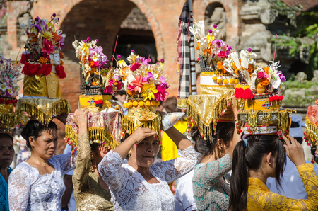 Balinese villagers participating in traditional religious Hindu procession before Ogoh-ogoh parade and Nyepi day (Balinese New Year) in Ubud, Bali, Indonesia