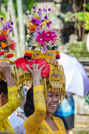 Balinese villagers participating in traditional religious Hindu procession before Ogoh-ogoh parade and Nyepi day (Balinese New Year) in Ubud, Bali, Indonesia.